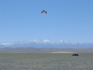 kiting by snow covered mts 705671